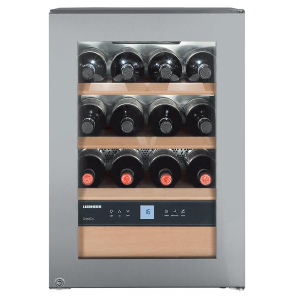 Винный шкаф до 140 см LiebherrВинные шкафы до 140 см<br>Звук.сиг. повышения темп.: Да,<br>Количество компрессоров: 1,<br>Свет.сиг. повышения темп. : Да,<br>Гарантия: 2 года,<br>Количество камер: 1,<br>Цифровой дисплей: 1,<br>Страна: Австрия,<br>Вес: 32 кг,<br>Габаритные размеры (В*Ш*Г): 61*43*48 см,<br>Открытие дверцы: направо,<br>Цвет: нерж. сталь,<br>Класс энергоэффективности: A,<br>Индикация включения: Да,<br>Объем холодильной камеры: 47 л,<br>Энергопотребление в год: 146 кВтч,<br>Материал полок: дерево,<br>Климатический класс: SN,<br>Макс. кол-во бутылок в камере: 12,<br>Вид гарантии: по чеку<br>